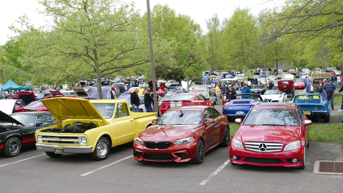 cars lined up at the New Hope Automobile Show Cars & Coffee in Peddler's Village